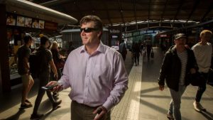 blind man with GPS app inside a railway station Melbourne