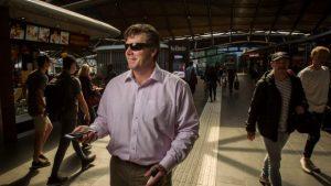 blind man with GPS app inside a railway station Melbourne